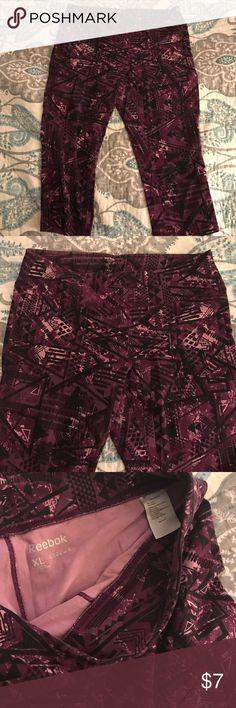 Reebok capri workout pants Tee box Capri workout pants. Fun tribal design in purple, black, and pink. Worn once. Reebok Pants Capris