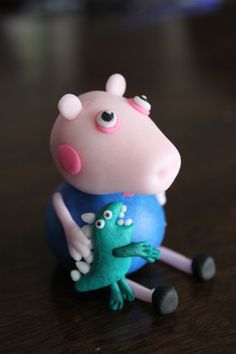 Peppa Pig's George and Dinosaur cake topper made with homemade marshmallow fondant