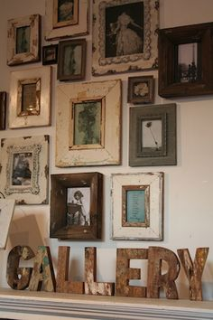 Framed Photographs...love the mix of frames and materials as well as the black and white photos too!