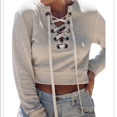 ❄️Lace Up Cropped Sweater Size S❄️ Cute and unique lace up cropped sweater size small! Perfect winter wardrobe essential! Completely new and unused (not LF just listed for exposure) Not available yet! Like the listing and when I receive it, I will drop the price and you will be notified :) LF Sweaters
