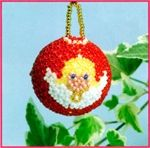 Beaded Angel bauble using 9/0 Toho beads and a pattern from Stenboden.