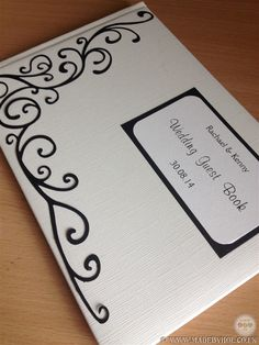 Bespoke papercut wedding guest book with swirls in black & white colours