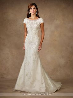 Hand-pattern beaded and embroidered motif on tulle over organza and soft satin trumpet gown with cap sleeves, front and back bateau necklines trimmed with elaborately hand-beaded illusion, dropped waist, covered buttons down back, chapel length train. Colors: Ivory, White Sizes: 0 – 20, 18W – 26W