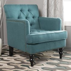 The Malone Fabric Club Chair features traditional styling like tufted panels and nailhead trim that are sure to elevate the sophistication of your setting.