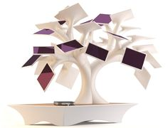 """Solar  Charging Bonsai  """"Inspired by trees photosynthesis, the solar bonsaï Electree is equipped with 27 solar panels allowing you to recharge your nomad electronic devices battery with the help of solar energy."""""""