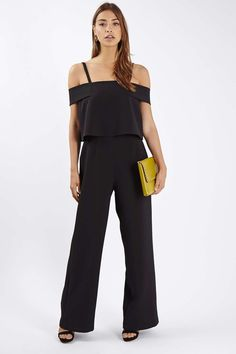 All-in-one jumpsuits are the perfect addition to party styling this season. Crafted in a chic black, this style comes detailed with a bardot style cold-shoulder neckline, and layered bodice.