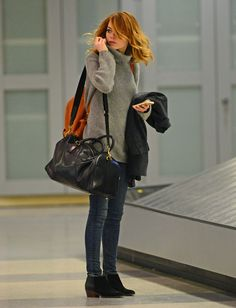 Emma Stone arrives at JFK Airport on January 13, 2014. 3