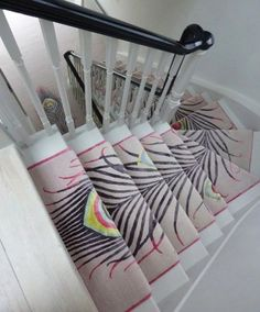 Tail Feather. Peacock feather runner spanning 4 flights of stair in a London townhouse. Wow