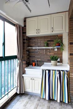 Stripes and soft white shades. Love the use of that simple curtain to hide the oven! #home #decor