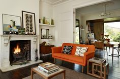Orla Kiely's house, home, interior, design, fireplace, living room, sofa, shelving