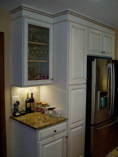 ... , Salazzo granite countertops, wine glasses, kitchen appliances More