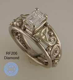 White Gold engagement ring with celtic knots and a diamond.