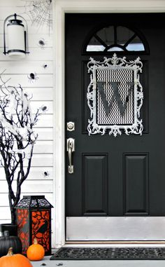 Black and white monogrammed decor—along with spiders and cobwebs—creates quite the spooky Halloween entrance.