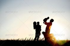 Silhouette of Happy Family and Dog ...  Bonding, animal, baby, beautiful, bliss, celebrate, child, children, copy space, dad, dog, dusk, enjoying, family, father, four, happy, head, holding, hugging, joy, joyful, kid, laughing, lift, lifting, love, loving, mom, mother, night, over, people, pet, puppy, raising, silhouette, silhouetted, silhouettes, sky, smile, smiling, son, sunset, text, toddler
