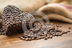 Coffee bag and heart from coffee beans on table, warm , shallow, brown