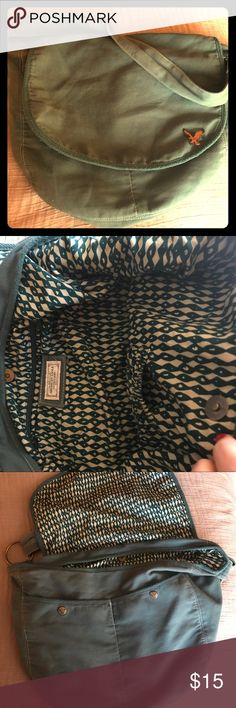 American Eagle Outfitters Teal Messenger Bag Super cute AEO messenger bag in a sun kissed teal color. Pretty sure it's 100% cotton so the small spot on the inside can be easily washed out. It has a pocket for your phone and a zipper pouch on the inside, and two large pockets when you lift up the top. I loved this bag when I was at school, but I've graduated-whoop!!! American Eagle Outfitters Bags Satchels