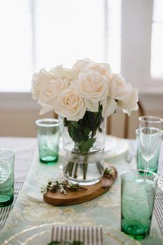 Simple white rose centerpiece.