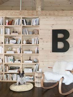 An updated 1950s cabin by designer and homeowner Bobby Houston takes knotty-pine paneling into the 21st century with a whitewash treatment and integrated shelving. Get his secrets here.