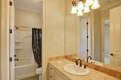 Spacious secondary bathroom with an oversized vanity.
