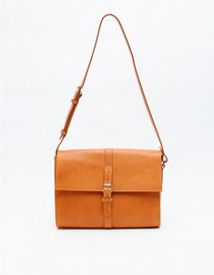 Minimal satchel-style leather shoulder bag from A.P.C. Features adjustable leather shoulder strap, roomy interior with inside pocket and smooth leather lining, and simple buckle closure.  100% Leather