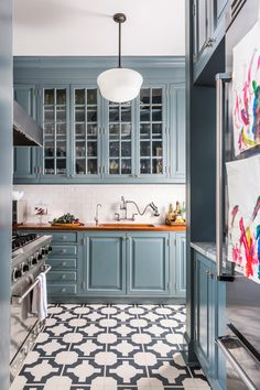 We can't get over this beautiful and functional blue kitchen from designer Cece Barfield Thompson's NYC home