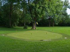 Here's a sprawling, lush lawn with this professional looking green resting at the center. Subtly rolling surface includes multiple holes and is shaded by nearby hardwood trees. Artificial Putting Green, Outdoor Putting Green, Golf Putting Green, Golf Green, Green Mat, Lush Lawn, Backyard Patio, Backyard Ideas, Outdoor Patios