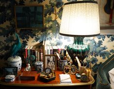 Christopher Spitzmiller lamps in a custom blue-green glaze are surrounded by more favorite objects, books and photos.