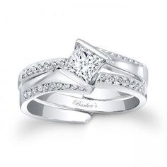 Princess Cut Bridal Set - Unique interlocking diamond wedding set featuring a low profile cathedral shank engagement ring that rises to capture the channel set princess diamond center securely in its grasp, while pave set diamonds cascade down the shoulders. A pave set diamond wedding ring slips into the split open shank. Available in gold and platinum.