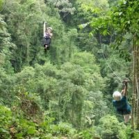 Ziplining in the rainforest of Costa Rica. I've done it in CA but...