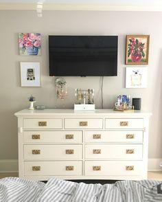 Tv over dresser in bedroom