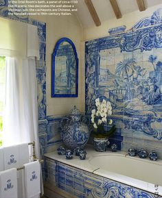 Anouska Hempel ~ panel of 1730's Dutch tiles decorate wall above Victorian tub, handled vessel is 19th c Italian and cache-pots are Chinese