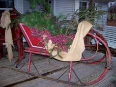 We decorated our horse drawn sleigh with cuttings from our pine/ evergreen trees on our property.  Completed it with burlap and rag garland!