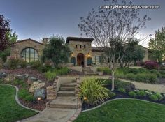 Beautiful former Serrano Street of Dreams custom home with numerous Tuscan design elements, including exposed stone facade, low pitched roof lines, recessed wood windows and wood shutters, arched windows, wrought ironwork, and a grand stone entry tower.