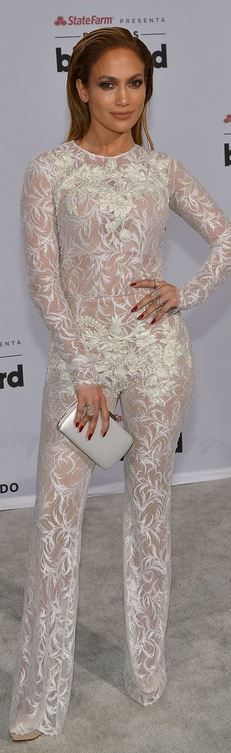 Jennifer Lopez: Jumpsuit and cape – Zuhair Murad  Shoes – Charlotte Olympia  Purse – Brian Atwood