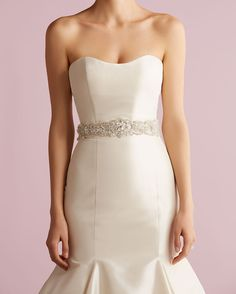 Intricate rhinestone sash with diamond detailing by Alllure Bridals. For the Bride Boutique Ft. Myers, Florida