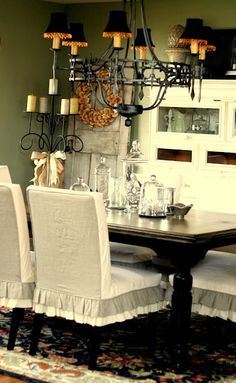 ruffle dining room chairs...I want to see the rest of this fabulous room