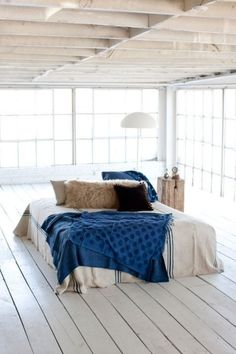 This is how I picture my dream room. LOVE the windows, the bed placement...EVERYTHING!