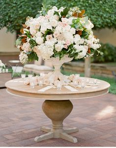 Place card table decoration - Luxurious urn arrangement with ivory and blush roses - from Anna Lucia Events - MODwedding Tent Reception, Reception Decorations, Flower Decorations, Reception Design, Reception Card, Wedding Arrangements, Wedding Centerpieces, Floral Arrangements, Wedding Tables