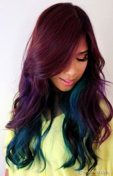 This contains so many jeweled tones, and it's so unexpected. I love the dark dramatic shade up top. #hair #coloredhair