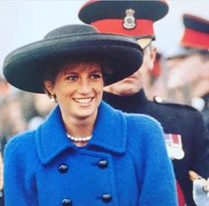 Update: December 01, 1990:  The Princess of Wales inspects the officer cadets at the Sovereign's Parade held at the Royal Military Academy in Sandhurst, Surrey, December 1990. The Princess wears a blue wool coat with a Philip Somerville black hat.