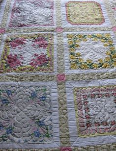 Vintage hankies were appliqued onto a white cotton.  Sashing and a border completed this delightful quilt.  Special custom feather quilting was added to enhance the feminine quilt.