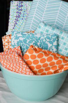 LOVE!! Beautiful orange and turquoise quilt fabrics.