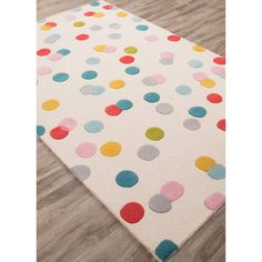 Add a joyful burst of confetti to your room with this polka dot rug.  This hand-tufted rug will brighten any room.  100% Wool.  Imported.