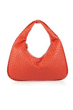 Most Iconic It Bags: Bottega Venetta woven bag. The criss cross, plaited effect is created using Intrecciato, a technique invented by Bottega Veneta in the 1960s to make the thin leather used in the workshops stronger and more durable for accessories. Today, most of Bottega Veneta's bags feature a take on the Intrecciato weave.