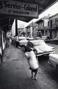 "Street Scene with ""Service for Colored"" Sign. New Orleans by Leonard Freed, 1965."