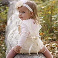 Miss Spencer takes our breath away in this stunning moment with our Anna Romper!  The delicate lace detail still looks gorgeous paired with long sleeves and knee highs for fall #crushing  Back in stock and ready to ship sizes 6m to 24m leave emailnand size below to order