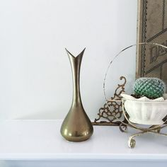Hey, I found this really awesome Etsy listing at https://www.etsy.com/listing/293959483/vintage-mid-century-brass-bud-flower