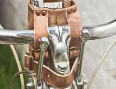 Handmade with the highest quality leather, this vintage-style cup holder attaches to your handlebars with belt straps so you can ride in style without spilling a drop!