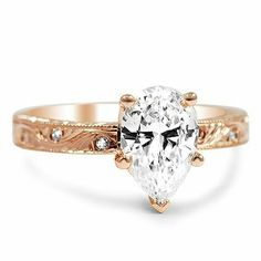 Love the rose gold engagement ring