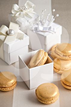 Find This Pin And More On Lembrancinhas De Batizados Gold Macarons In White Bo As Wedding Favors